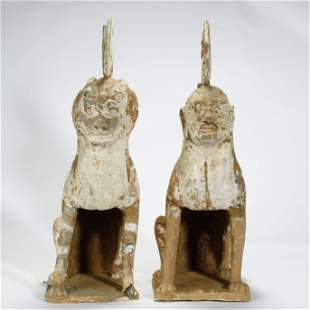 TANG DYNASTY,A PAIR OF PAINTED POTTERY MYTHICAL BEASTS