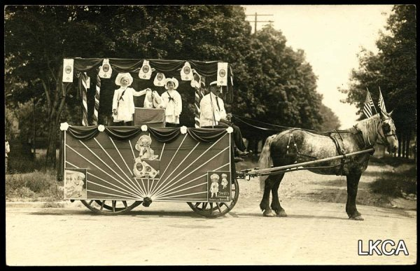 10:     RPPC Postcard MI Horse Drawn Advertising Float