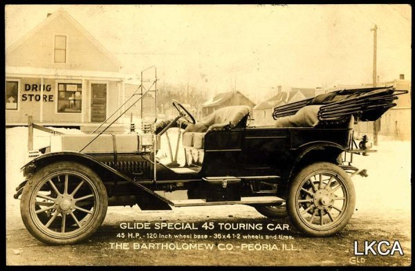 17:     RPPC Postcard Advertising Peoria IL Touring Car