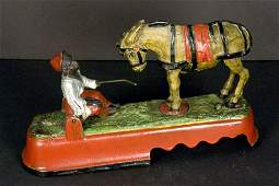 """Mechanical Cast Iron Bank, """"Always Did 'Spise a Mule"""""""