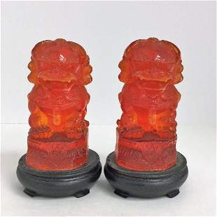 Antique Pair of Detailed Carved Cherry Amber Foo Dogs