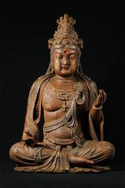 A LIAO DYNASTY PAINTED WOODEN BUDDHA STATUE