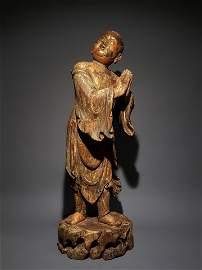 A YUAN DYNASTY WOOD CARVED LACQUER BOY