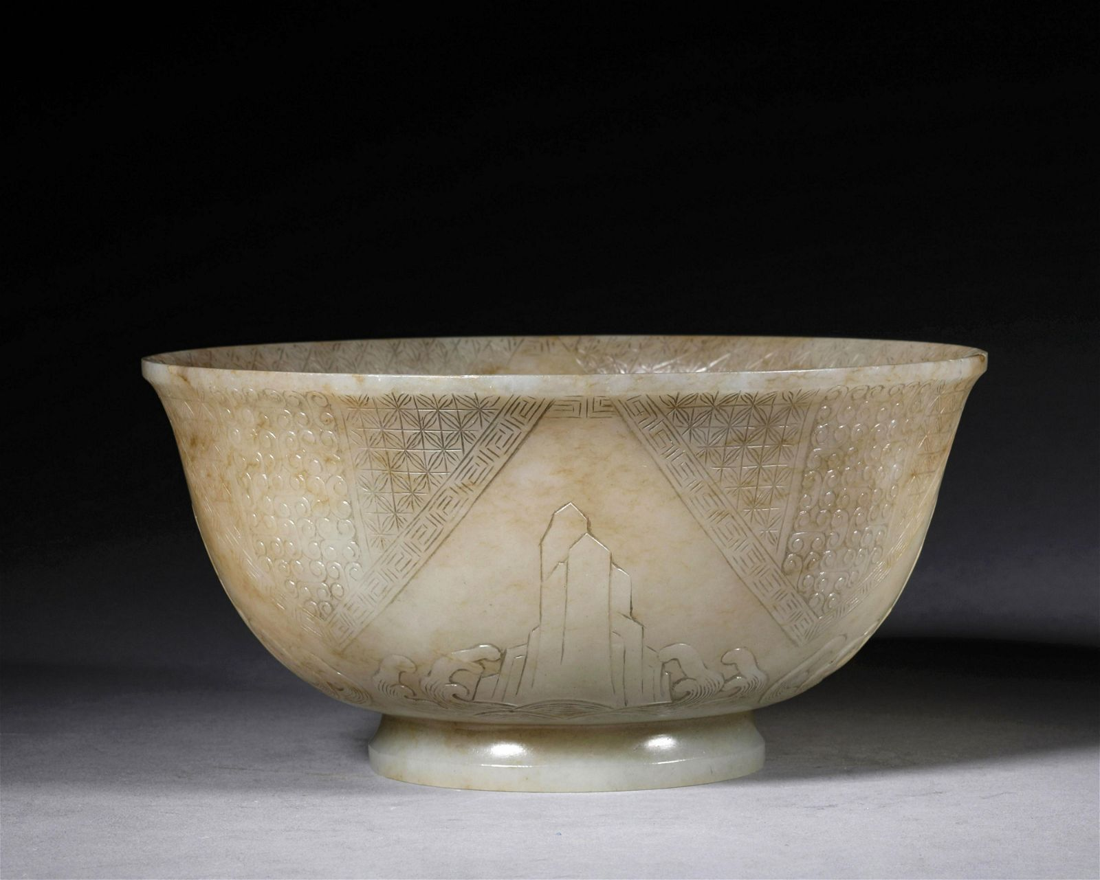 A QING DYNASTY CARVED WHITE JADE BOWL