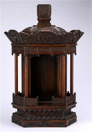 A QING DYNASTY CARVED ROSEWOOD BUDDHIST ALTAR