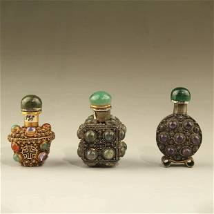 A Group Of Three Silver Snuff Bottles