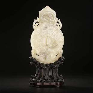 A Carved White Jade Bi