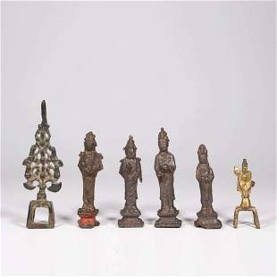 A Group Of Six Bronze Buddhas