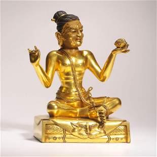 A Gilt Bronze Seated Master