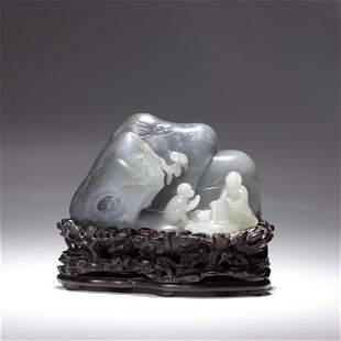 A Carved Gray Jade Boulder