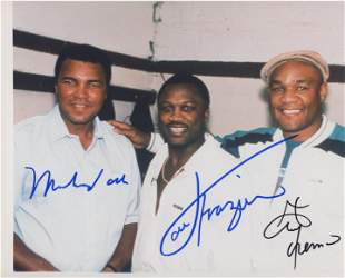 Muhammad Ali, Joe Frazier and George Foreman signed