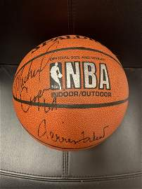 Jerry West and Michael Cooper signed basketball