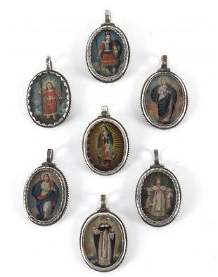 A collection of seven colonial reliquary pendants in