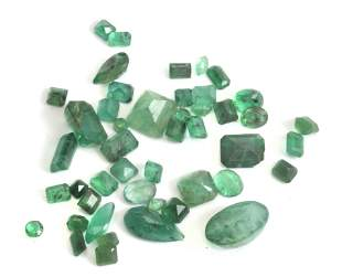 A collection of 46 loose emeralds