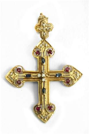 A sapphire, ruby and diamond pendant cross with an