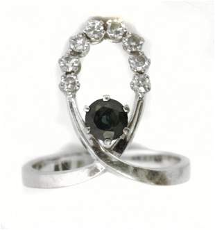A sapphire and diamond ring circa 1960-1969 with an