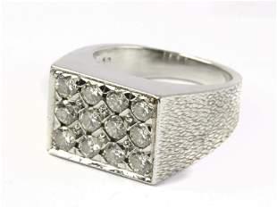 A brilliant cut diamond signet ring in platinum