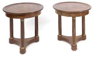 A pair of Empire style mahogany and bronze side tables