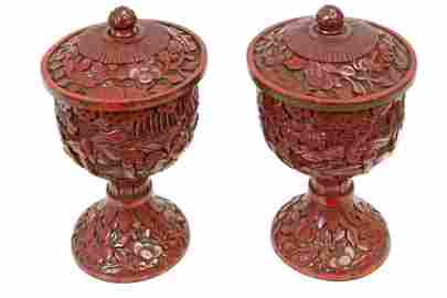 A pair of 18th century cinnabar lacquer vases and
