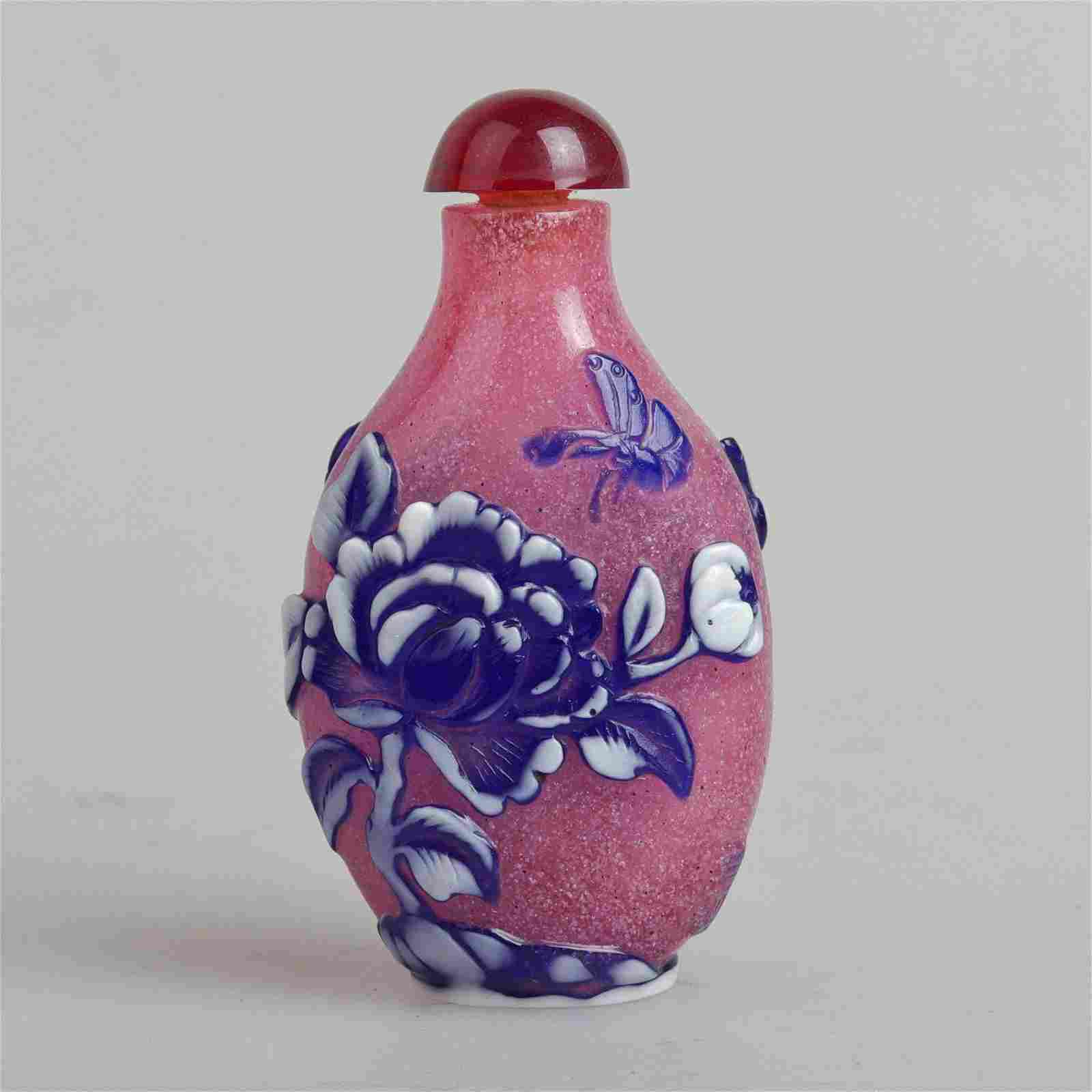 a chinese overlaid snuff bottle in the 19th century