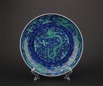 A blue glazed 'dragon' plate