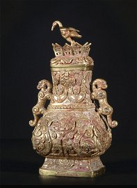 A gold 'beast' winepot