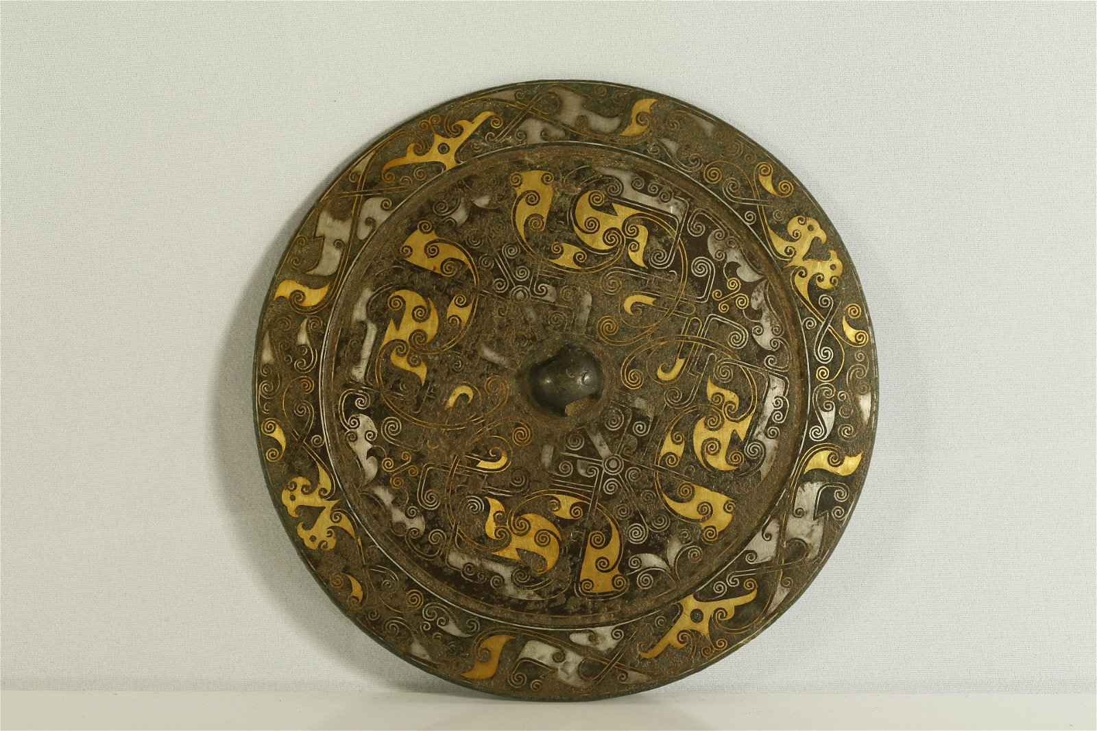 A Very Rare Gold and Silver-Inlaid Bronze Mirror