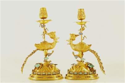 A Fine Pair of Gilt-Silver 'Phoenix' Candlesticks