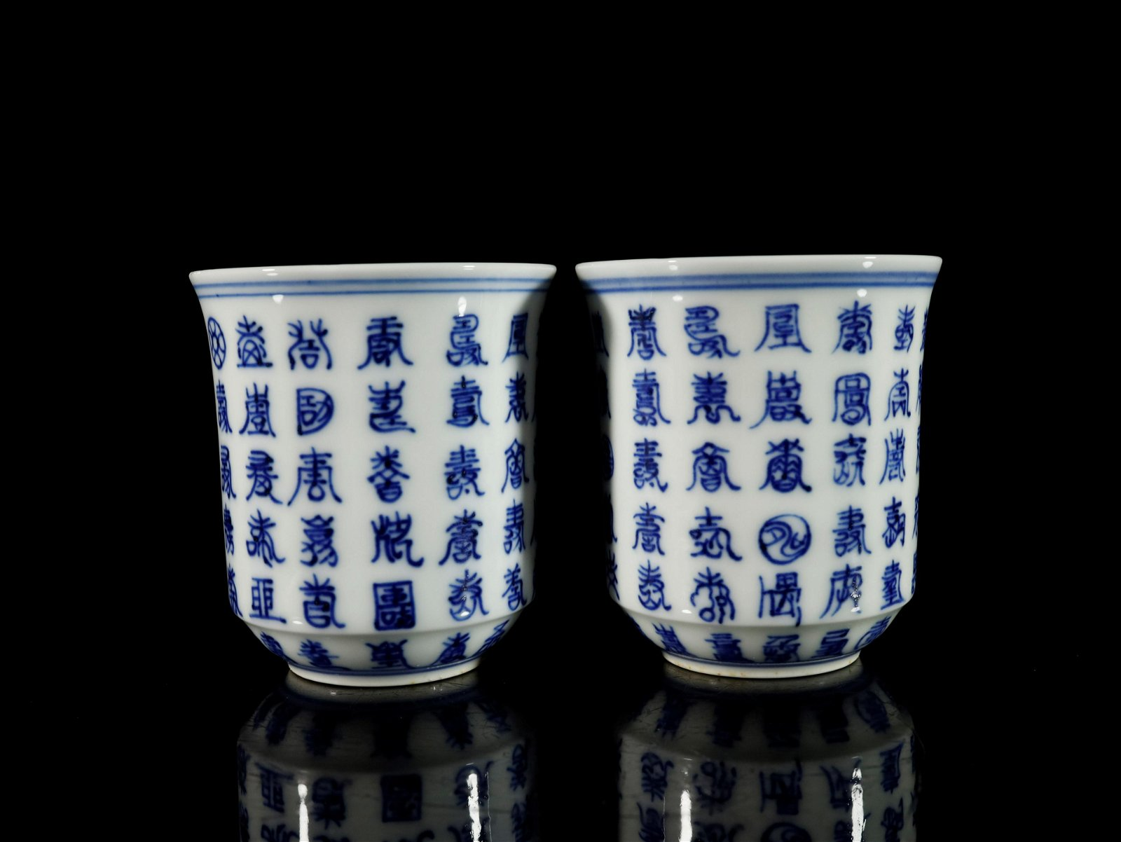 A Fine Pair of Blue and White Cups