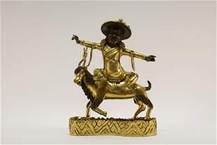 A Gilt Bronze Mammon Statue