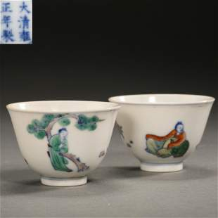 PAIR OF CHINESE QING DYNASTY DOUCAI FIGURE CUPS