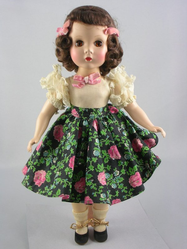 "10: 14"" MAGGIE BY ALEXANDER IN FLORAL SKIRT"