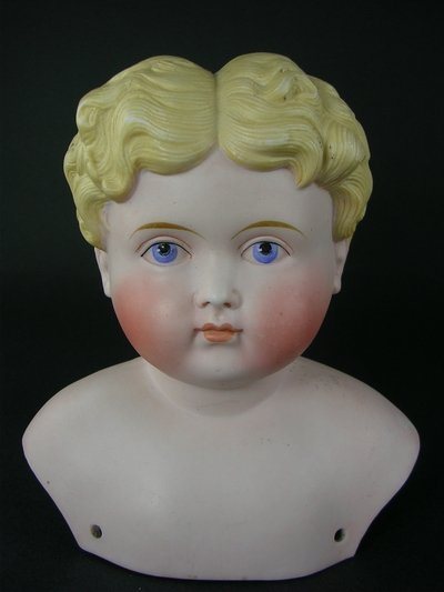 "23E: 7"" TINTED BISQUE GERMAN SHOULDER HEAD (ONLY) BOY"