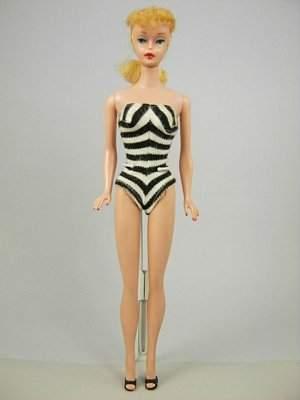#5 Ponytail Barbie wearing original swimsuit