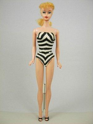 6: #5 Ponytail Barbie wearing original swimsuit