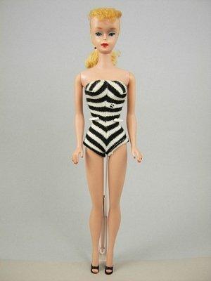 10: #5 Ponytail Barbie wearing original swimsuit