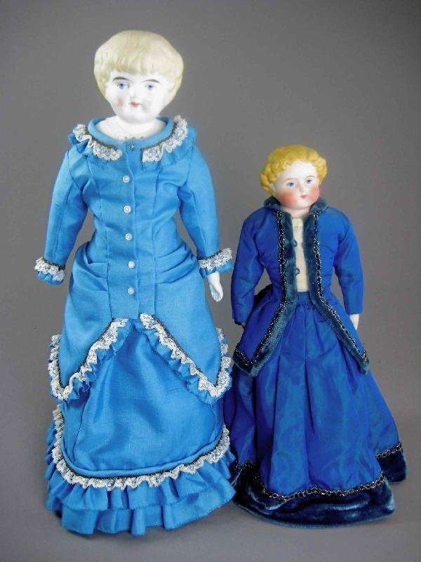 TWO BLONDE PARIAN TYPE DOLLS