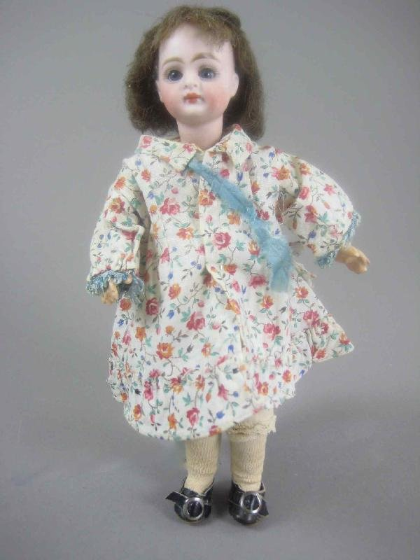"9"" BISQUE HEAD DOLL ON FULLY JOINTED BODY"