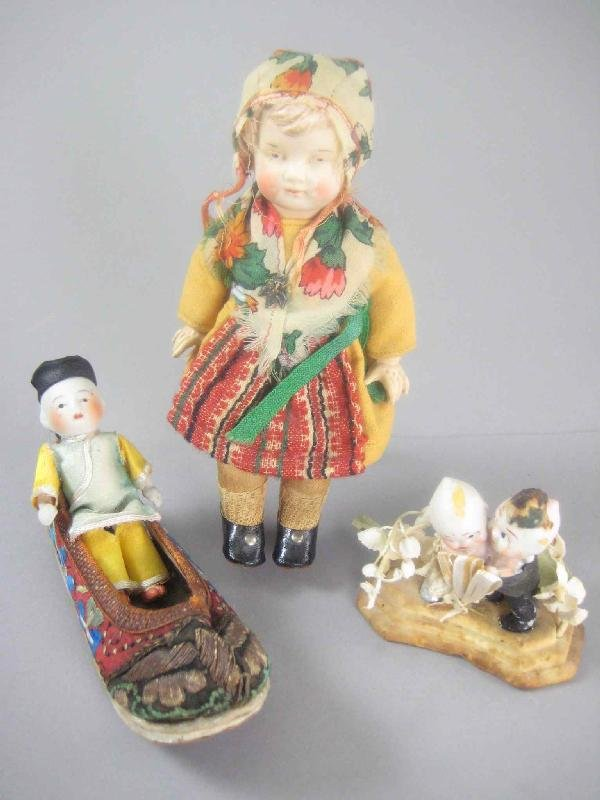 GROUP OF BISQUE AND CELLULOID DOLLS