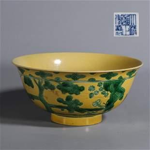 A yellow glazed figure porcelain bowl