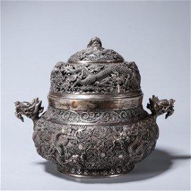 A dragon patterned silver incense burner