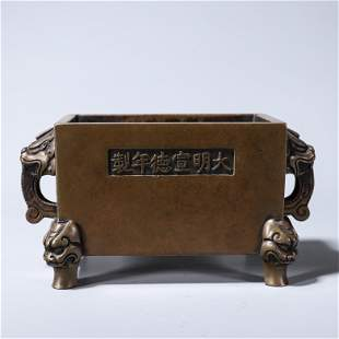 A squared copper censer with beast shaped ears