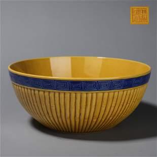 A yellow glazed porcelain bowl
