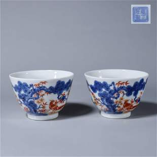 A pair of blue and white iron red porcelain cups