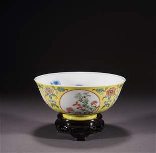 A yellow glazed 'floral' bowl