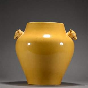 A yellow glazed jar