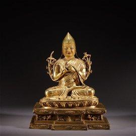 A gilt-bronze statue of Guru