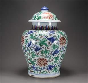 Qing Kangxi style wu cai porcelain cover jar