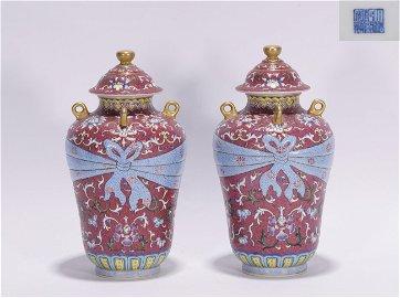 A pair of Qing Qianlong style enamel porcelain vases