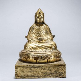 A gilding copper buddha statue with silver eyes
